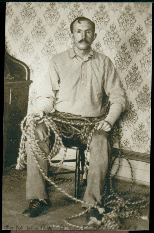 "Tom Horn tying lariats. Photofile: ""Horn, Tom,"" Negative Number 1267. Tom Horn, UW American Heritage Center."