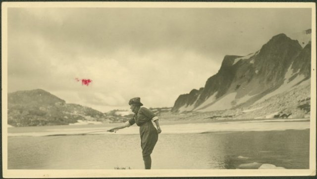 "Grace Raymond Hebard fishing at one of the lakes in the Snowy Range mountains. Photofile: ""Hebard, Grace Raymond."" Neg. #18168. University of Wyoming American Heritage Center."