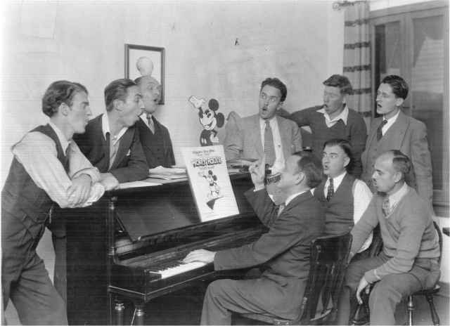 "1929 Walt Disney Animation Staff.  Carl Stalling is seated at the piano.  AHC Photo File: ""Stalling, Carl."" UW American Heritage Center."