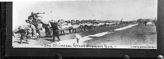Photo of the traditional Chinese New Year dragon performance from the 1890s in Rock Springs, WY.  W.B.D. and Annette B. Gray Papers, #1053, Box 17.