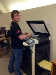 UW student using scanner in the American Heritage Center reading room.  Photograph by AHC faculty.