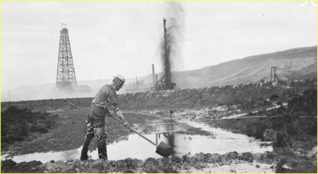 Oil Gusher and Overflow, Carbon County, Wyoming, 1920. Frank Meyers Collection